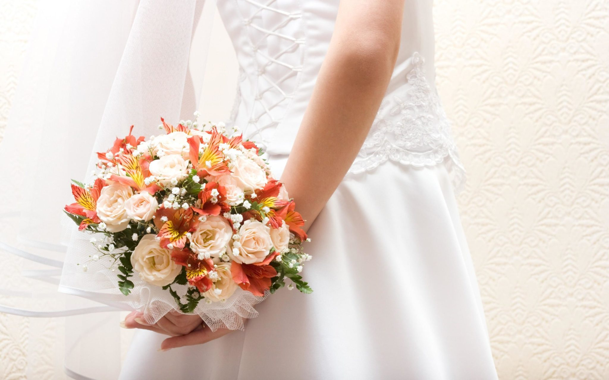 picture of a pride with flower bouquet in her hands held behind her back